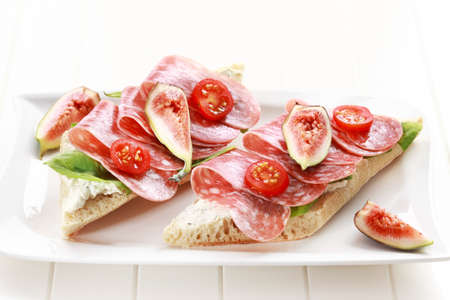cold cuts: Two baguettes with lettuce, salami and fresh figs