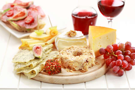 antipasti: Catering cheese platter with red wine