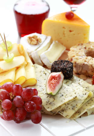 Catering cheese platter with red wine photo