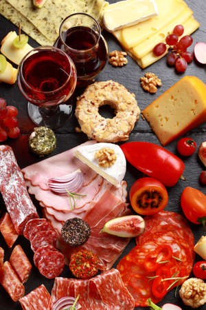 antipasto platter: Antipasto catering platter with red wine Stock Photo