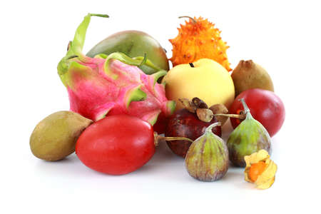 Exotic fruits - mangosteen, fig, mango, Asian pear, dragon fruit, horned melon, tamarillo Stock Photo - 14161543