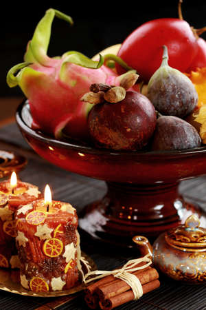 Still life with exotic fruits  - mangosteen, fig, dragon fruit, horned melon, tamarillo Stock Photo - 14161735