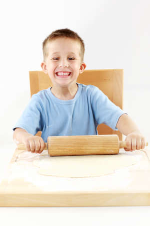 Small boy baking cookies for Christmas Stock Photo - 14304797