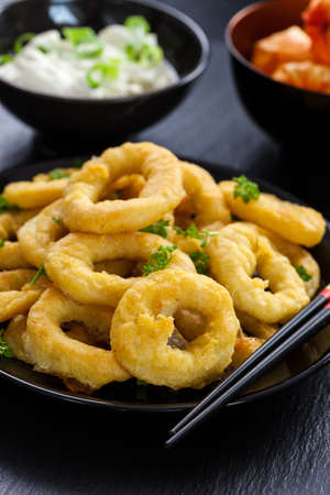 Fried calamari rings with yogurt garlic dip Stock Photo