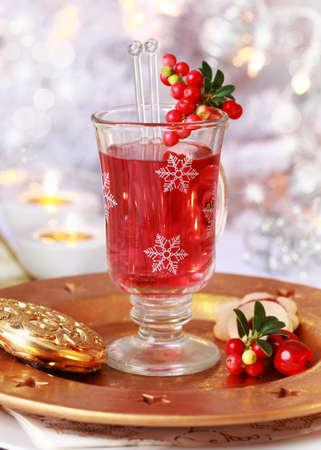 spiced: Close up of mulled wine glass with cranberry