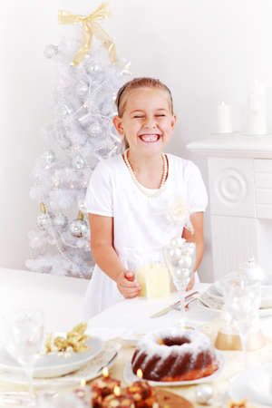 Happy girl helping set the Christmas table Stock Photo - 15058353