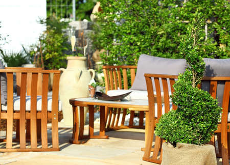garden furniture: Garden terrace with wooden furniture and plants