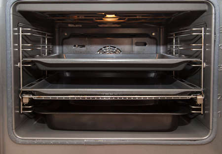 Modern oven with tray inside photo