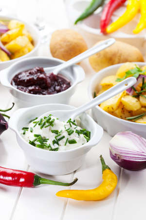Sour cream and chutney with baked potatoes Stock Photo - 15542651