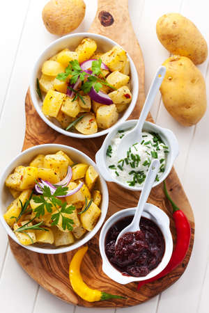 Baked potatoes with chutney and sour cream - top view Stock Photo - 15542647