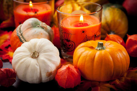 Happy Halloween - pumpkins and candles still life photo