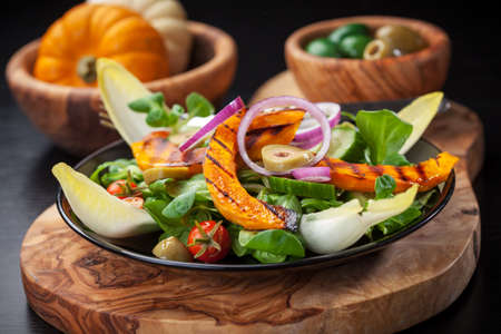 Delicious field salad with grilled pumpkin stripes for Thanksgiving Stock Photo - 15542643