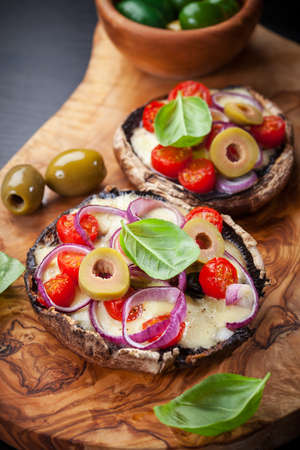 Giant Portobello mushrooms stuffed with mozzarella and tomatoes  photo