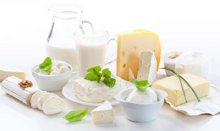milk jugs: Assortment of dairy products on white background