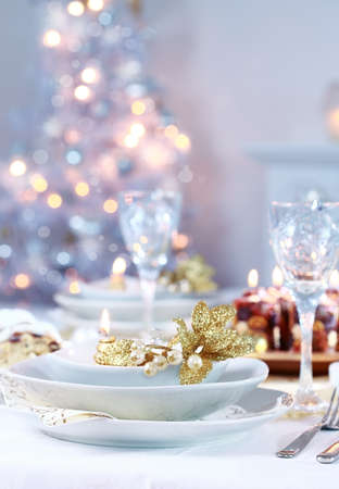 dinnerware: Place setting with Christmas tree in background Stock Photo
