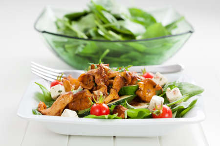 spinach salad: Spinach salad with roasted chanterelle mushrooms on grilled zucchini