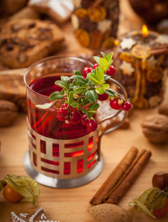 Hot wine punch with cinnamon and cranberry photo