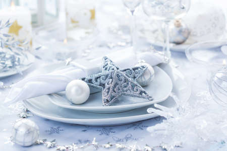 Place setting in white and silver for Christmas with star photo