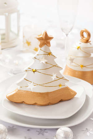 Festive table for Christmas in white and golden tones photo
