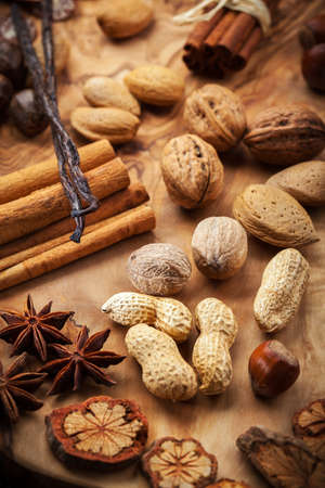 Assortment of spices and nuts for Christmas for baking cookies photo