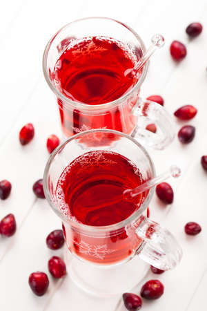 Hot drink with cranberries on white Stock Photo - 16435941
