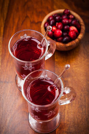 Hot drink with cranberries on white Stock Photo - 16435943