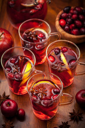 Glasses with hot punch for winter and Christmas with fruits and wine photo