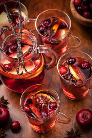 Delicious hot punch for winter and Christmas with fruits and wine photo