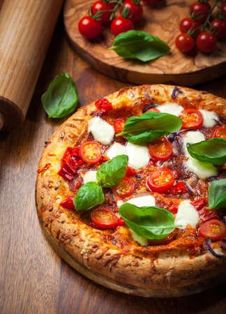 custard slices: Pizza with salami, mozzarella and basil