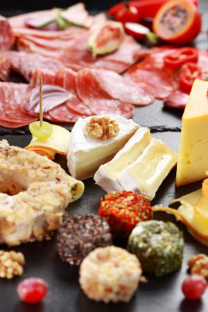Antipasto catering platter with salami and cheese photo