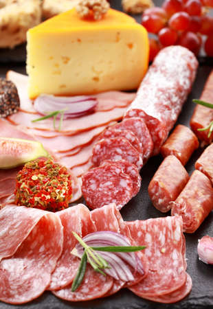 to cut: Antipasto catering platter with salami and cheese Stock Photo