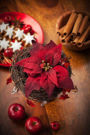 Christmas flower with decoration on wooden table photo