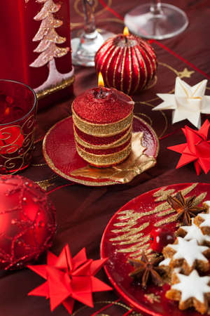 Christmas candles with paper stars on festive table Stock Photo - 16833842