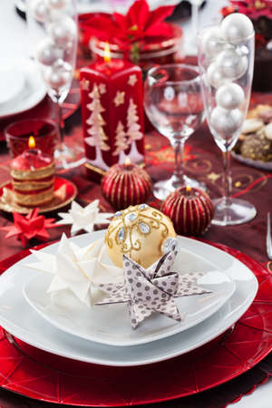 Place setting Christmas decorated with paper star photo