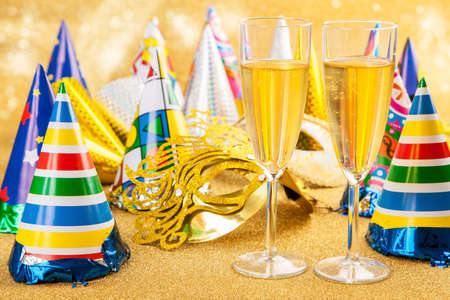 glases: Masquerade Mask with champagne and party hat. Happy New Year.