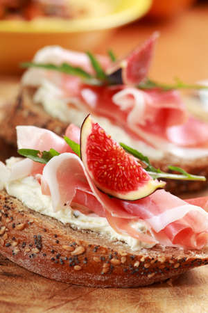 Sandwich with prosciutto, goat cheese and fig photo