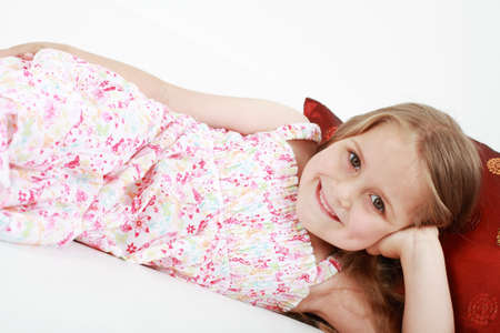 Cute playful little girl relaxing photo