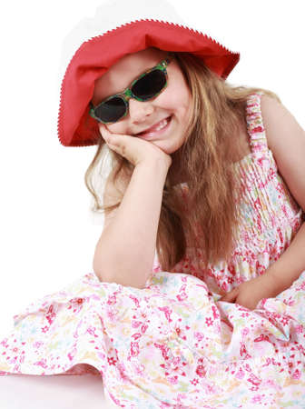 Cute funny little girl with summer hat and sunglasses photo