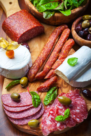 antipasto platter: Antipasto catering platter with different meat and cheese products