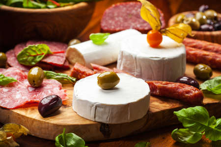 Antipasto catering platter with different meat and cheese products