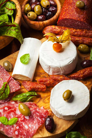 Antipasto catering platter with different meat and cheese products photo