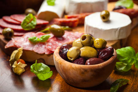 buffet lunch: Fresh olives and antipasto catering platter