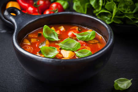 minestrone: Homemade delicious minestrone soup with basil Stock Photo