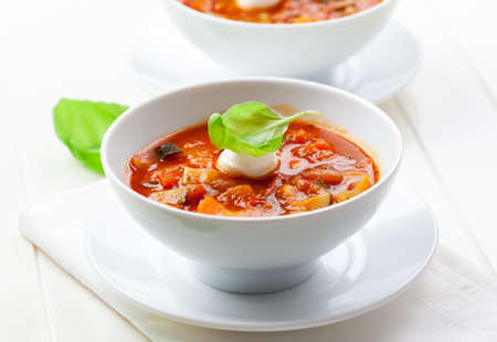 vegetable soup: Delicious minestrone soup with mozzarella and basil Stock Photo