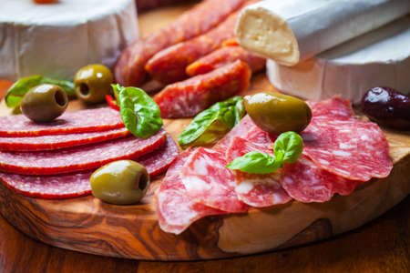smoked sausage: Salami catering platter with different meat and cheese products