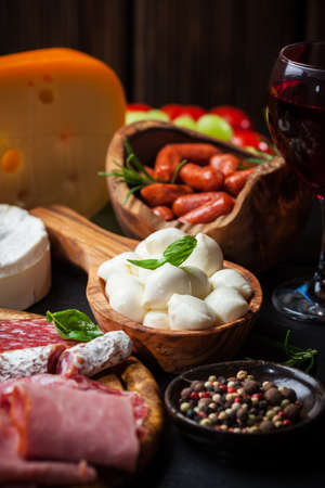 Antipasto and catering platter with different meat and cheese products photo