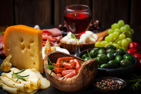 antipasto platter: Antipasto and catering platter with different meat and cheese products