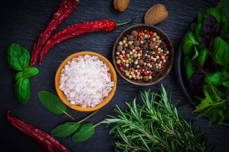 Spices and herbs on black background
