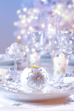 Decorated Christmas table with tree in background Stock Photo