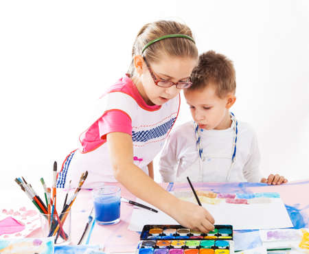 Casual kids painting with watercolor